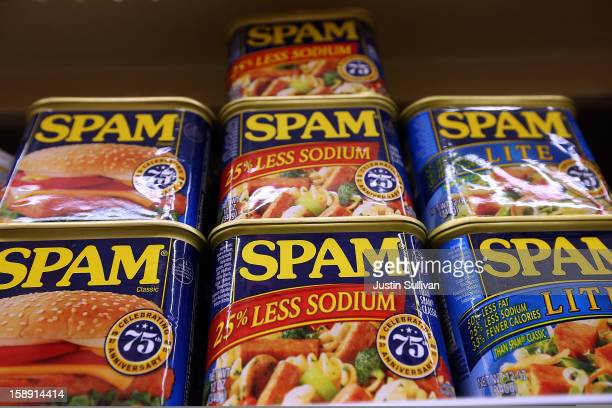 Cans of Spam are displayed on a shelf at Cal Mart grocery store on January 3 2013 in San Francisco California Hormel the maker of Spam announced that...