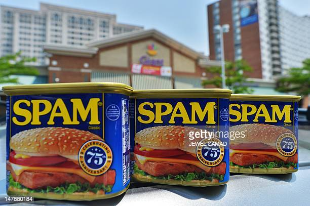 Cans of Spam meat made by the Hormel Foods Corporation are pictured outside a store in Silver Spring Maryland on July 5 2012 Hormel's famous canned...