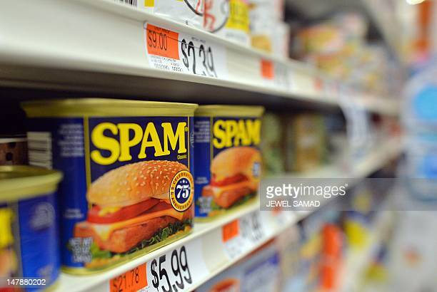Cans of Spam meat made by the Hormel Foods Corporation are pictured in a store in Silver Spring Maryland on July 5 2012 Hormel's famous canned meat...