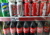 Cans of Sprite Diet Coke and CocaCola are offered for sale at a grocery store on April 17 2012 in Chicago Illinois The CocaCola Co reported an 8...