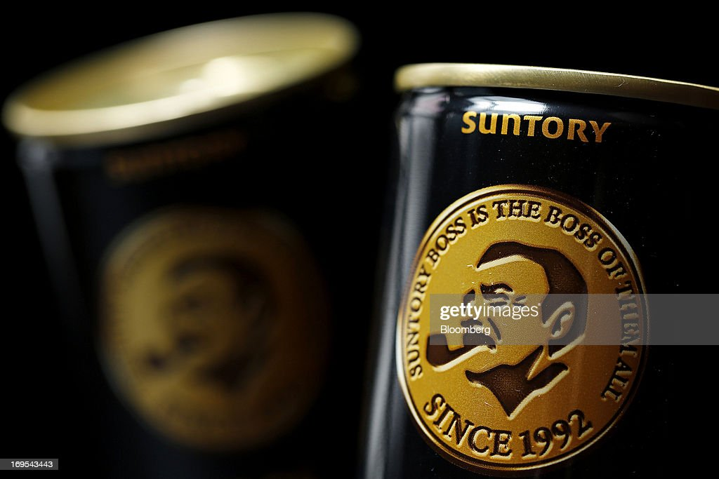 Cans of Suntory Beverage & Food Ltd.'s Boss brand coffee are arranged for a photograph in Soka City, Saitama Prefecture, Japan, on Sunday, May 26, 2013. Nomura Holdings Inc., Morgan Stanley and JPMorgan Chase & Co. were selected as the lead banks to manage Suntory Beverage & Food Ltd.'s initial public offering, said two people with knowledge of the matter. Photographer: Kiyoshi Ota/Bloomberg via Getty Images
