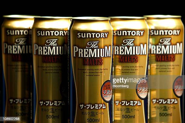 Cans of Suntory Holdings Ltd beer are arranged for a photograph in Soka City Saitama Prefecture Japan on Tuesday Feb 8 2011 Suntory Holdings Ltd the...