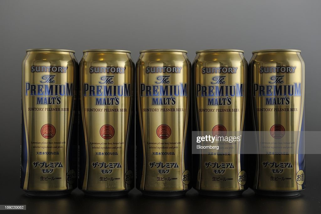 Cans of Suntory Holdings Ltd. Premium Malt's beer are arranged for a photograph in Kawasaki, Kanagawa Prefecture, Japan, on Wednesday, Jan. 9, 2013. Suntory Holdings Ltd. plans to hire Nomura Holdings Inc. as a lead underwriter for the initial public offering of its non-alcoholic drinks and food business, said two people with direct knowledge of the matter. Photographer: Akio Kon/Bloomberg via Getty Images