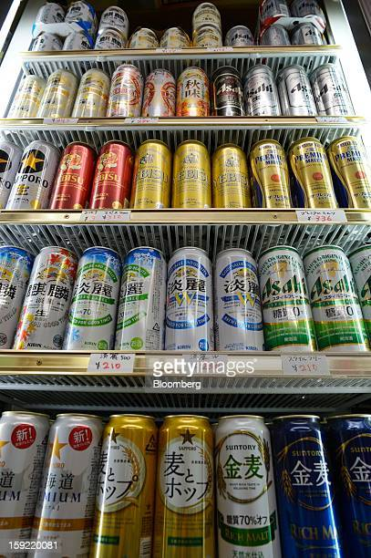 Cans of various brands of Kirin Brewery Co beer Asahi Breweries Ltd Asahi Super Dry beer and Sapporo Breweries Ltd Yebisu beer are displayed for sale...