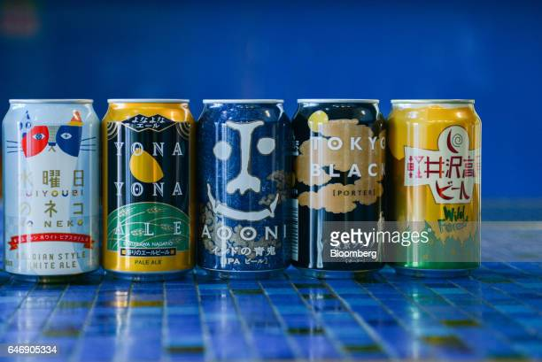 Cans of YoHo Brewing Co brand Suiyobi No Neko from left Yona Yona Ale Indo No Aooni Tokyo Black and Wild Forest beer sit on display at the company's...