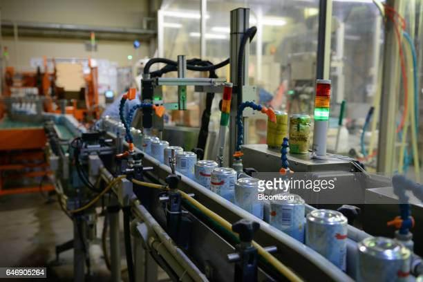 Cans of YoHo Brewing Co Suiyobi No Neko beer move along a conveyor on the production line at the company's brewery in Saku Nagano Prefecture Japan on...