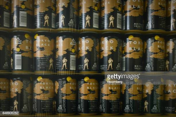 Cans of YoHo Brewing Co Tokyo Black beer sit stacked at the company's brewery in Saku Nagano Prefecture Japan on Friday Jan 6 2017 Craft brewers...
