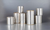 pile of silver cans on silver background