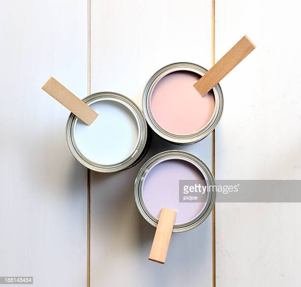 cans with brown, white and lavender paint