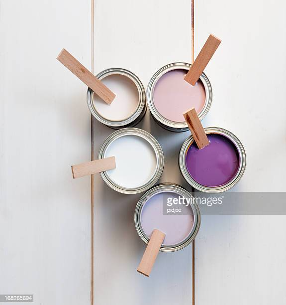 cans with purple, pink, white and lavender paint