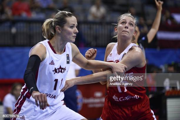 Cansu Koksal of Turkey in action against Aija Putnina of Latvia during the 2017 FIBA EuroBasket Women qualifications 5 to 6 between Turkey and Latvia...