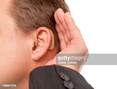 I can't hear you using hearing aid : Stock Photo