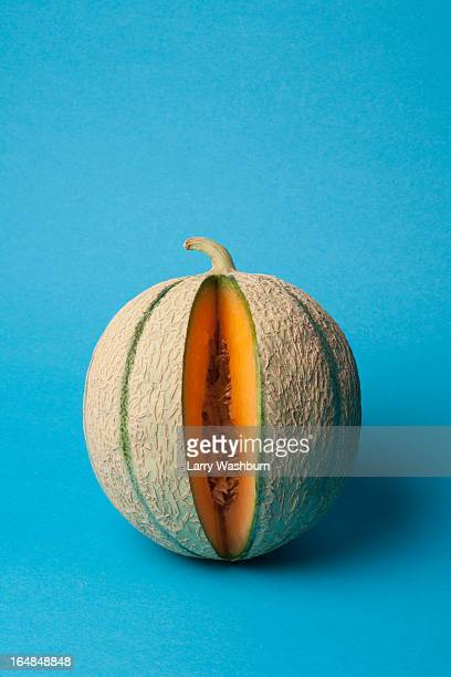 A cantaloupe with a slice removed