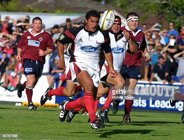 Canterbury Crusaders Daryl gibson chips ahead during the Telecom Super 12 Pre Season match played between the Canterbury Crusaders and the Queensland...