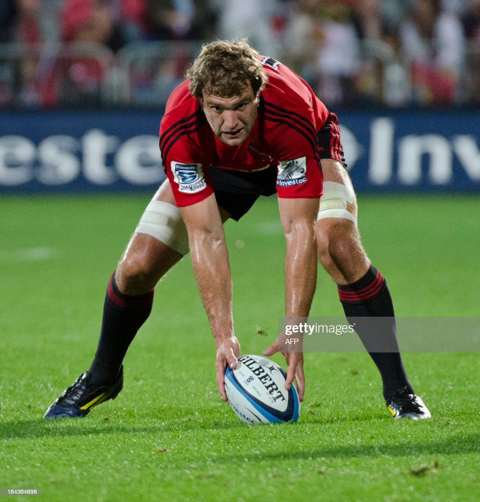 Canterbury Crusaders player Luke Whitelock (C) picks up a loose ball against the Southern Kings during their Super 15 rugby match in Christchurch on March 23, 2013. AFP PHOTO / David ALEXANDER