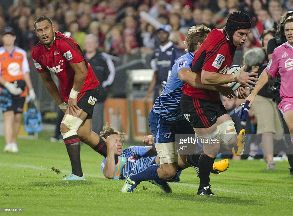Canterbury Crusaders player Matt Todd (2nd R) attempts to break through a tackle during their Super 15 rugby union match against South Africa's Northern Bulls at AMI Stadium in Christchurch on March 16, 2013. AFP PHOTO / David ALEXANDER
