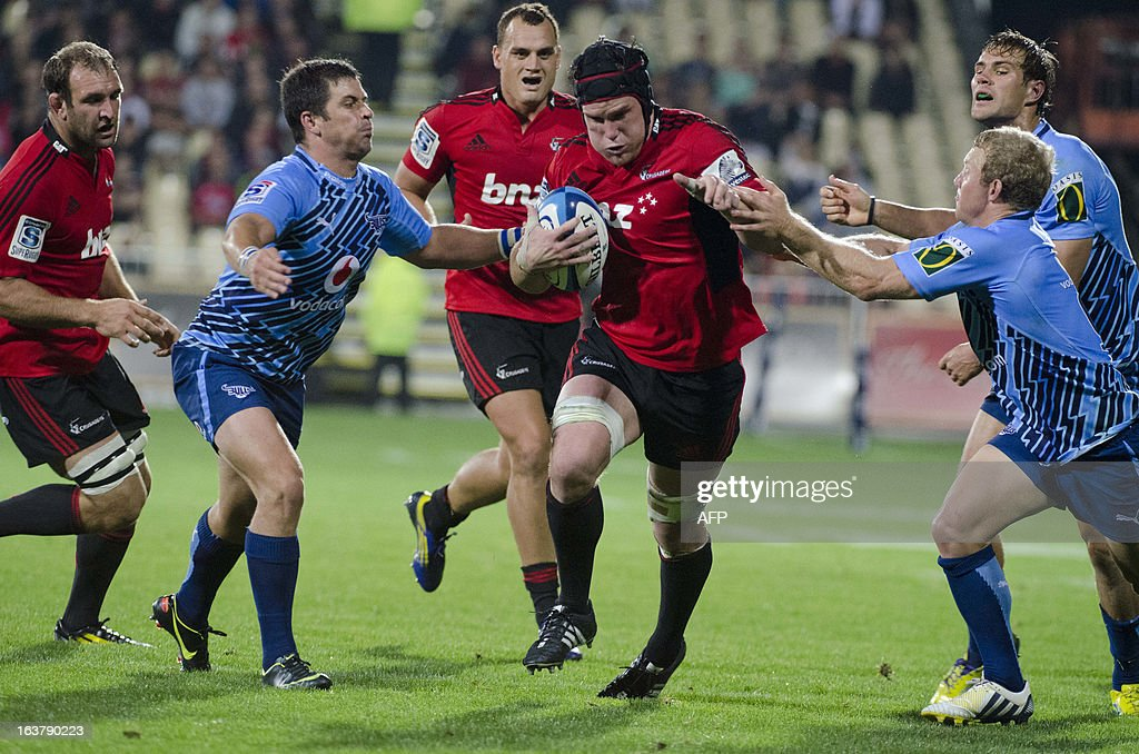 Canterbury Crusaders player Matt Todd (3rd R) runs with the ball during their Super 15 rugby union match against South Africa's Northern Bulls at AMI Stadium in Christchurch on March 16, 2013. AFP PHOTO / David ALEXANDER