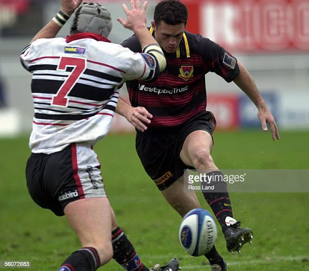 Canterbury wing Caleb Ralph chips over the head of Counties Manukau Glen Marsh during the Air New Zealand NPC first Division clash between Canterbury...