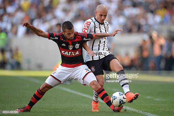 Canteros of Flamengo battles for the ball with Fabio Santos of Corinthians during the match between Flamengo and Corinthians as part of Brasileirao...