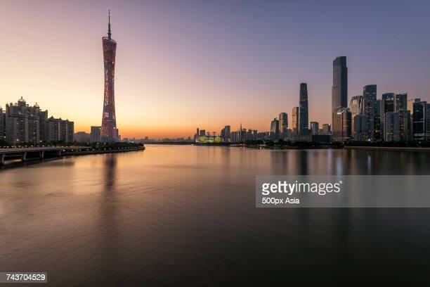 Canton Tower and waterfront skyscrapers at dusk, Guangzhou, Guangdong, China