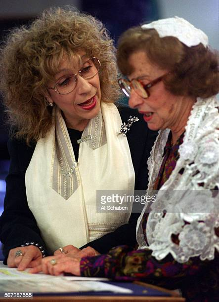 VIEJO––Cantor Shula Kalir–Merton left and mother Hilda Kalir chant together during rehearsal for the sabbath morning service and Benot Mitzvah...