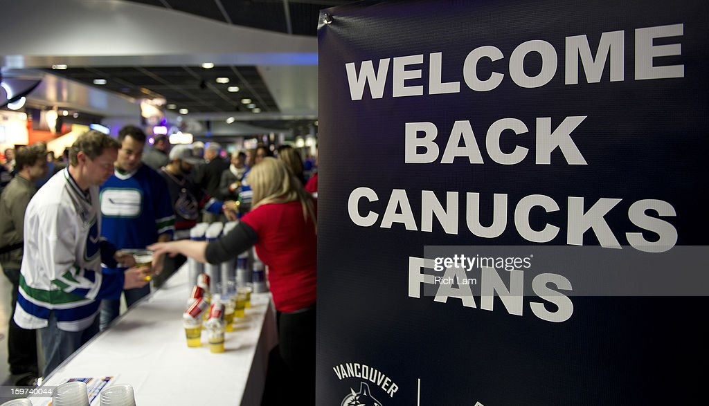 Canuck fans line up for a free beer prior to the start of NHL action between the Vancouver Canucks and the Anaheim Ducks on January 19, 2013 at Rogers Arena in Vancouver, British Columbia, Canada.
