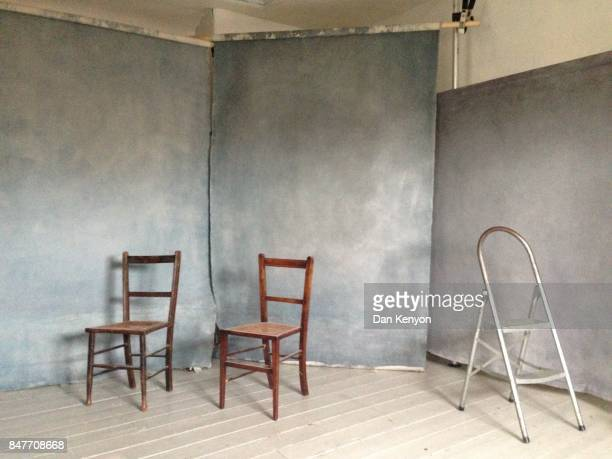 Canvas backdrops and chairs in photographer's studio
