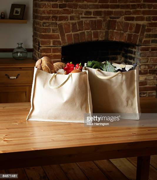 Canvas full of organic produce on kitchen table
