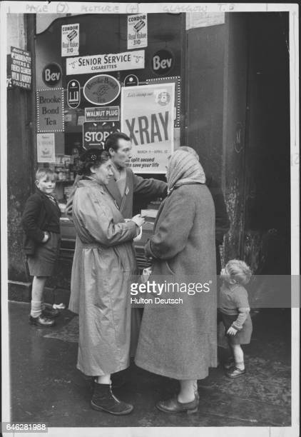 Canvassers interview people outside a Glasgow shop to try and encourage them to have a preventative xray as part of the nationwide campaign against...