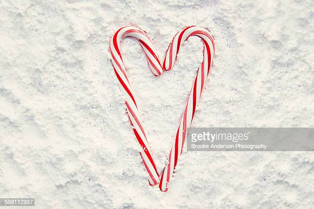 Cany cane heart in snow