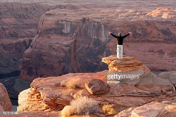 Canyon glory, one male hiker looks over Colorado river, Arizona.