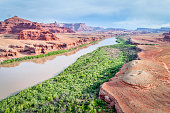 aerial view of the canyon of Colorado River near Moab, Utah, with a jeep trail
