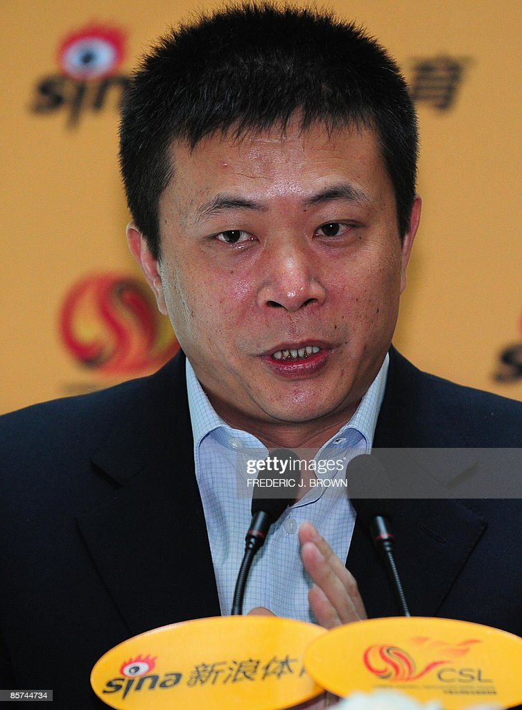 Cao Guowei, CEO of Sina.Com, China's largest web portal, gestures while speaking ahead of a signing agreement with the Chinese Super League on April 1, 2009 in Beijing, where Sina signed a 3-year sponsorship contract with the Chinese Football Association Super League, commonly known as Chinese Super League or CSL, which recently kicked off the 2009 season and is seeking to improve its image with a new sponsor, a new television deal and judicial oversight to weed out persistent graft and match-fixing. AFP PHOTO/Frederic J. BROWN