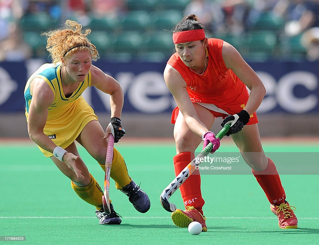 Cao Yannan of China attacks past Georgia Nanscawen of Australia during the Investec Hockey World League - Semi Finals match between China and Australia at The University of Westminster Sports Ground on June 29, 2013 in London, England.