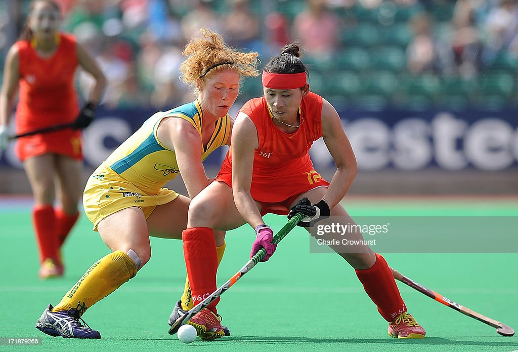 Cao Yannan of China holds off Georgia Nanscawen of Australia during the Investec Hockey World League - Semi Finals match between China and Australia at The University of Westminster Sports Ground on June 29, 2013 in London, England.