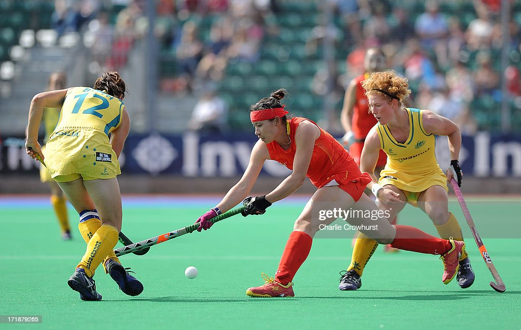 Cao Yannan of China looks to get past the Australian defence during the Investec Hockey World League - Semi Finals match between China and Australia at The University of Westminster Sports Ground on June 29, 2013 in London, England.