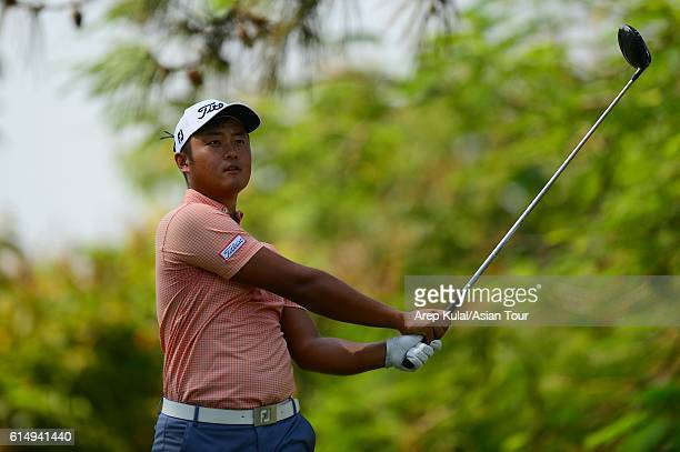 Cao Yi of China plays a shot during round four of the 2016 Venetian Macao Open at Macau Golf and Country Club on October 16 2016 in Macau Macau