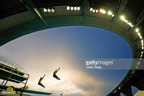 Cao Yuan and Lin Yue of China compete on in the Men's 3m Springboard Final during day three of the 19th FINA Diving World Cup at the Oriental Sports...