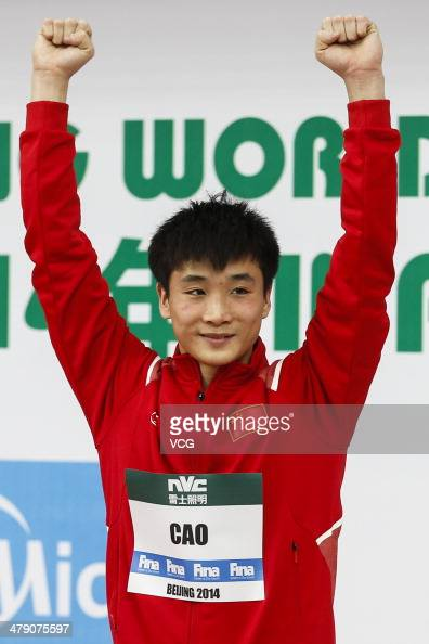 Cao Yuan of China celebrates on the podium after the Men's 10m Platform Diving final on Day 3 of the FINA/NVC Diving World Series 2014 on March 16 in...
