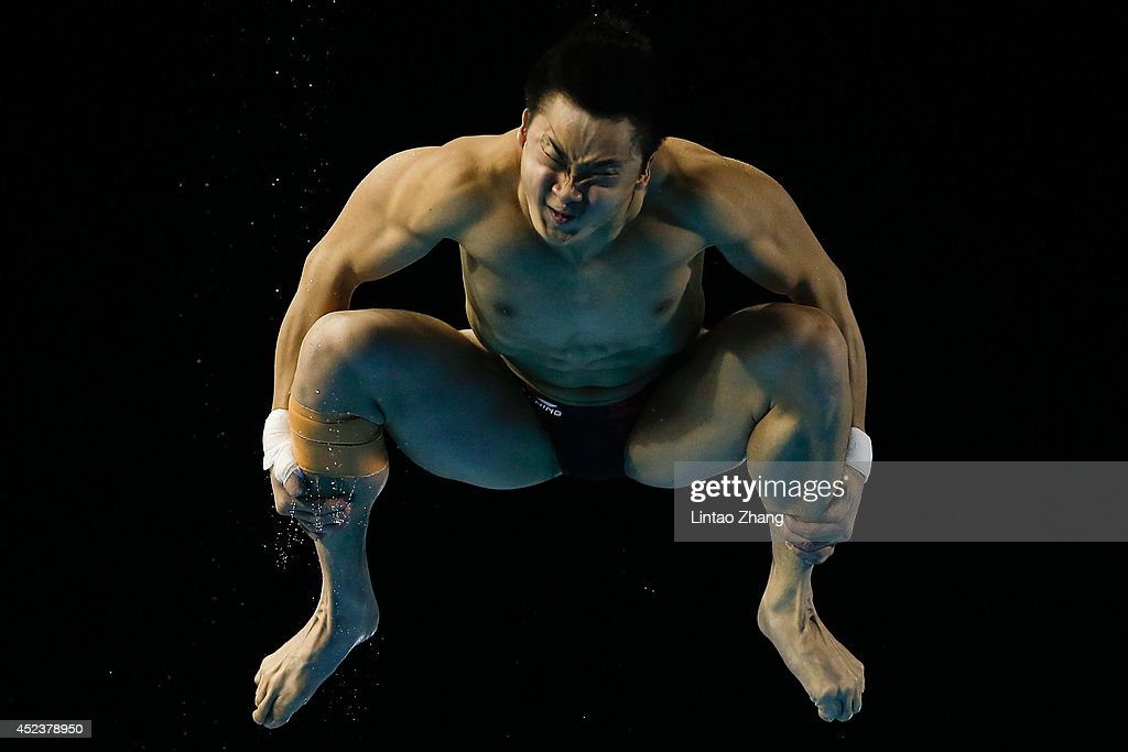 <a gi-track='captionPersonalityLinkClicked' href=/galleries/search?phrase=Cao+Yuan&family=editorial&specificpeople=5813673 ng-click='$event.stopPropagation()'>Cao Yuan</a> of China compete in the Men's 3m Springboard Final during day five of the 19th FINA Diving World Cup at the Oriental Sports Center on July 19, 2014 in Shanghai, China.