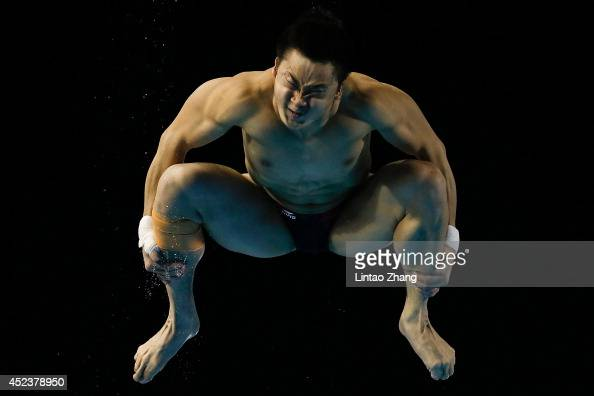 Cao Yuan of China compete in the Men's 3m Springboard Final during day five of the 19th FINA Diving World Cup at the Oriental Sports Center on July...