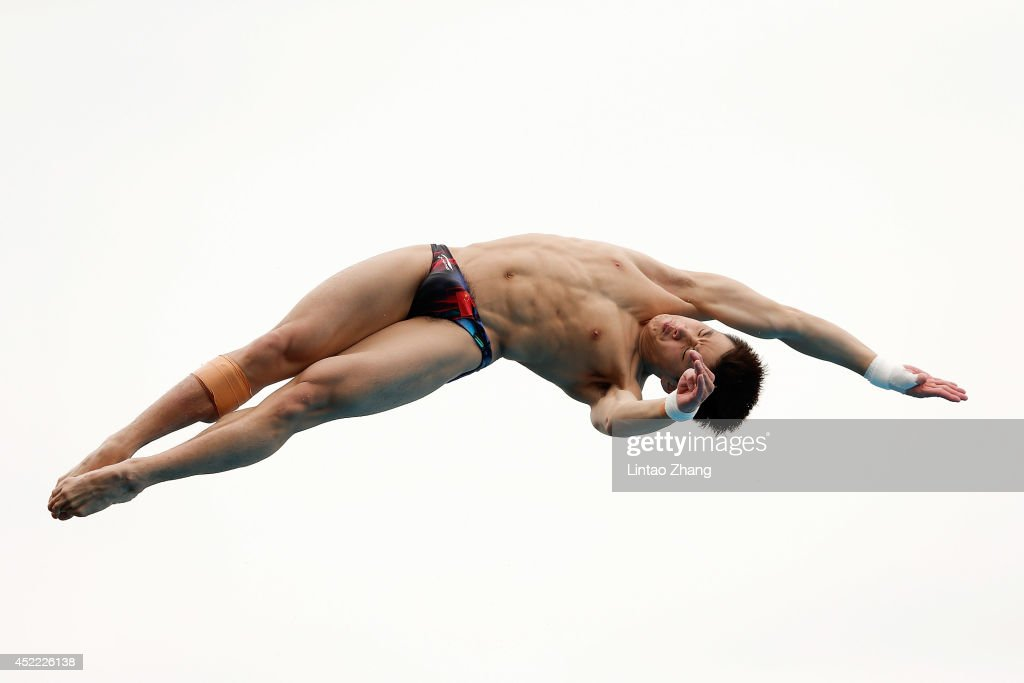 <a gi-track='captionPersonalityLinkClicked' href=/galleries/search?phrase=Cao+Yuan&family=editorial&specificpeople=5813673 ng-click='$event.stopPropagation()'>Cao Yuan</a> of China competes in the men's 10M Synchro Springboard Preliminary on day two of the 19th FINA Diving World Cup at the Oriental Sports Center on July 16, 2014 in Shanghai, China.