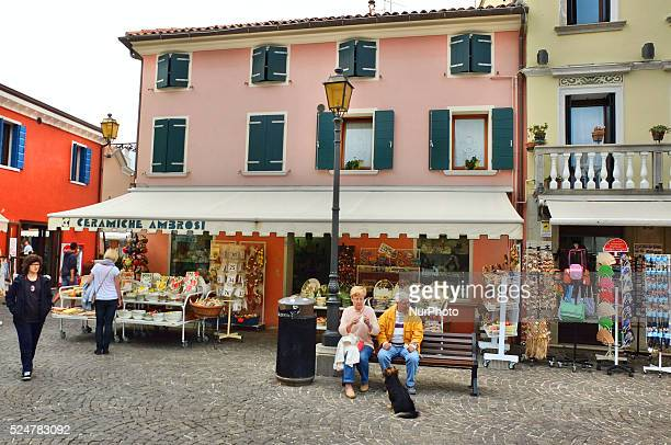 Caorle Veneto Italy May 2014 Eldery couple sits at the bench in Caorle old city