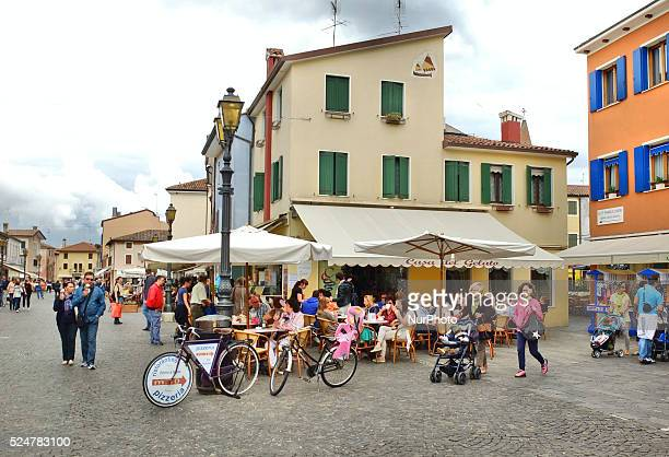 Caorle Veneto Italy May 2014 People sits in the Italian restaurant in the Caorle old city at the Adriatic sea coast