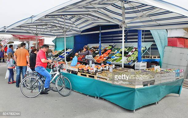 Caorle Veneto Italy May 2014 Saturday market day at the Caorle resort at the Adriatic sea coast Loca fruits Seller offers his goods to the tourists...