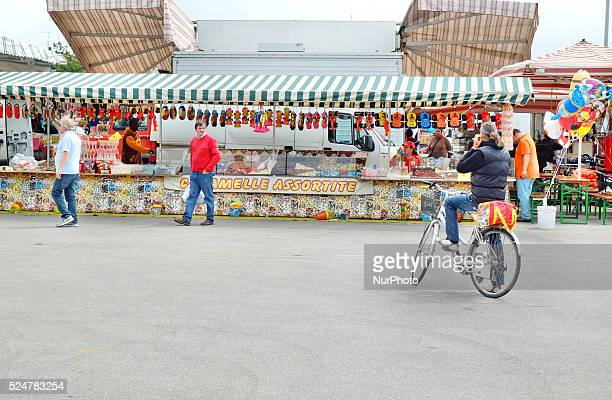 Caorle Veneto Italy May 2014 Saturday market day at the Caorle resort at the Adriatic sea coast Local candy Seller offers his goods to the tourists...