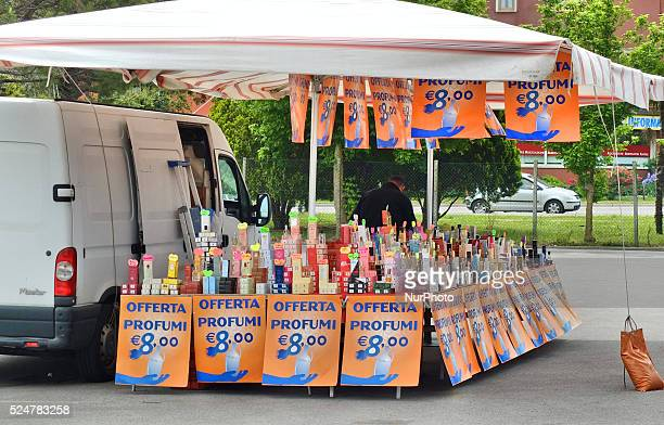 Caorle Veneto Italy May 2014 Saturday market day at the Caorle resort at the Adriatic sea coast Perfume seller offers his goods to the tourists and...