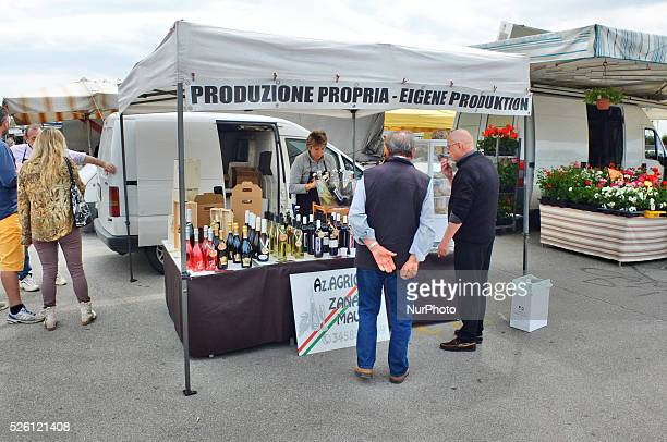 Caorle Veneto Italy May 2014 Saturday market day at the Caorle resort at the Adriatic sea coast Local wine Seller offers her goods to the tourists...