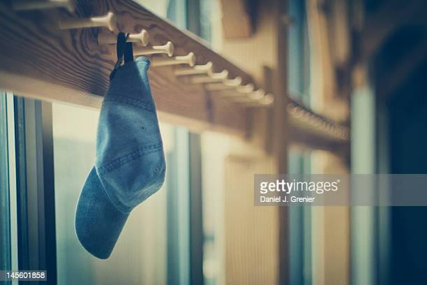 Cap hung on woeden coat rack