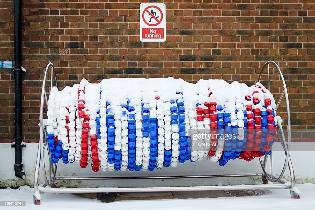 A cap of snow covers a roll of lane dividers at a lido in north London on January 19, 2013. While some people are savouring the cold conditions, snow that swept across Britain on January 18 continues to cause travel difficulties across the country.
